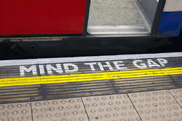 mind the gap sign on a subway