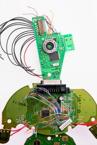 photo-circuitboard-man-665922320-med