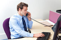 photo-salesperson speaking on phone